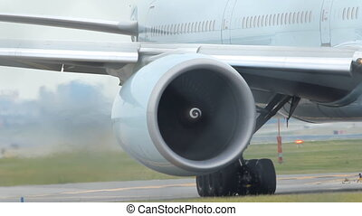 Jet Engine. - Commercial airliner taxiing on the tarmac....