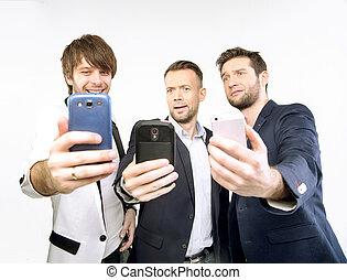 A few guys uisng their smart phones - A few guys uisng their...