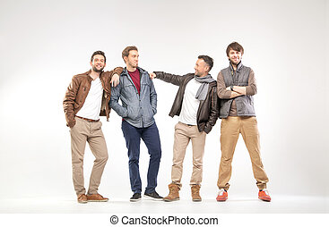 Group of smart guys advertising something - Group of smart...