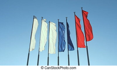Six red, blue and white flags fluttering on the wind