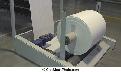 Big paper roll unreel for a printing press