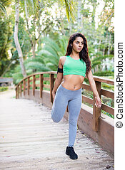 Woman stretching - Fitness woman stretching her body in the...