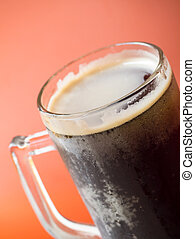 Root beer - Closeup shot of root beer glass isolated on...
