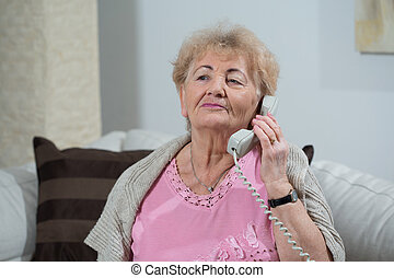 Close-up of phone talk - Close-up of nice elderly woman's...