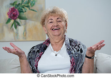 Happy woman - Photo of elderly happy woman in her apartment