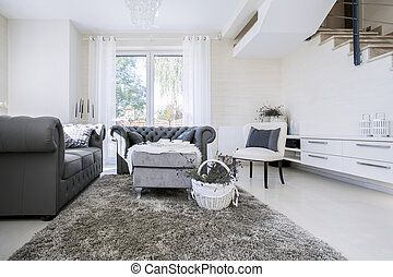 White living room with grey sofas - Big white living room...