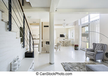 Spacious, bright living space with big windows