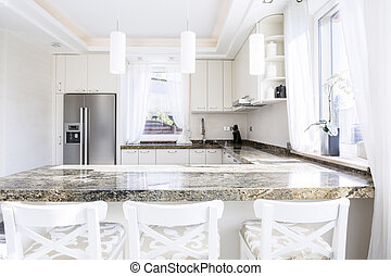 Granite worktop - Modern, white kitchen with long granite...