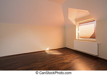 Spacious room with wooden flooring