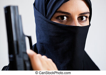 Close-up of woman with a gun