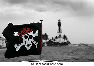 Pirates flag in black and red outdoor, lighthouse at the...