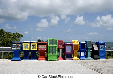 Row of newspaper boxes in Florida Keys
