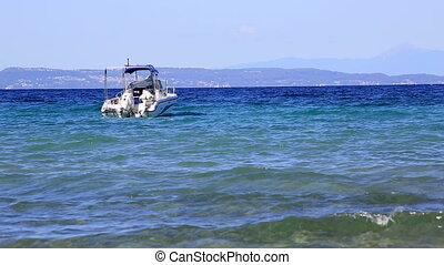 Boat bobs on the waves of Aegean Sea Sithonia peninsula...