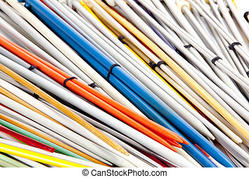 Closeup Group of Colorful Paired Knitting Needles - closeup...
