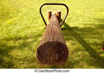 old wooden teeter totter in the park - old wooden balance...