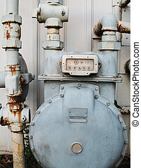 Old Gas Meter - Cropped shot of old, rusted gas meter on the...