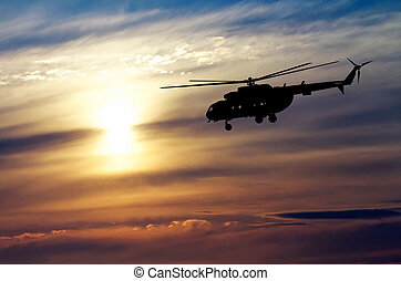 Picture of helicopter at sunset Silhouette of helicopter on...