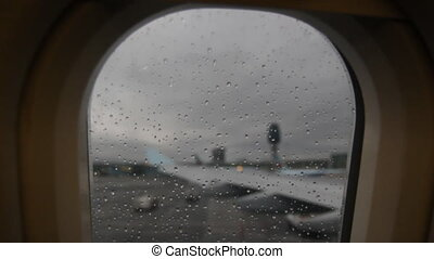 Rainy jet window.