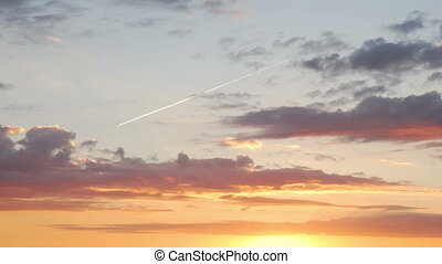 Traces of the aircraft at sunset - Time lapse shot of the...