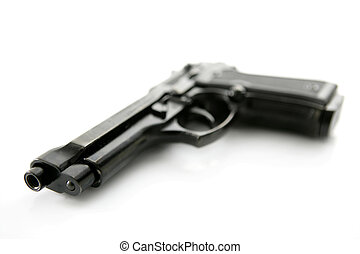 black hand gun pistol over white background, selective...