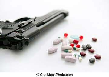 gun or pills two options to suicide, metaphor on white...