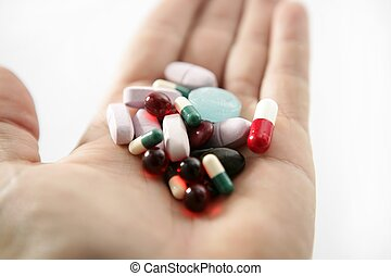 pills over white, health or suicide, metaphor