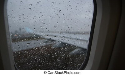 Rainy jet window. Taxiing. - Looking through window of a...