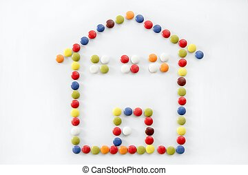 chocolate little candy sweets, house shape, isolated over...