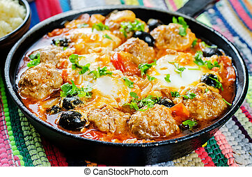 meatballs with olives and egg in tomato sauce Moroccan dish...