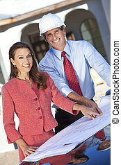Man Architect & Woman With Plans on Construction Site - Man...
