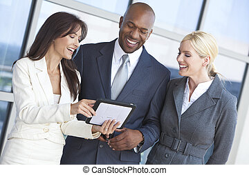 Interracial Business Team Using Tablet Computer - Man and...