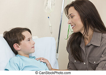 Young Boy Child Patient In Hospital Bed With Mother - Young...