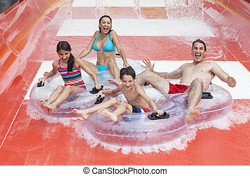 Mother Father Son Daughter Child Family Water Park - A happy...