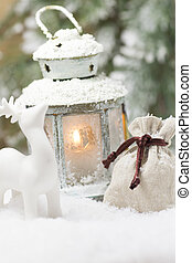 Christmas lantern. - Christmas scene. On snowy background...