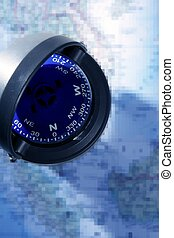 Blue nautical compass over blue chart map - Nautical compass...