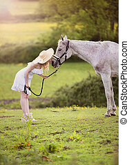 Woman with horse - Woman in white dress walking with horse...
