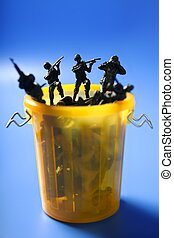 Toy soldiers row on the trash, end of war metaphor, peace