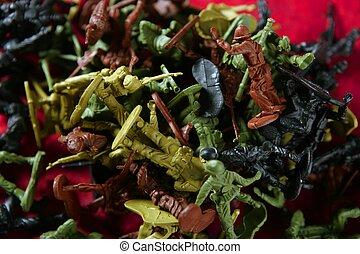 Metaphor of dead plastic toy war soldiers