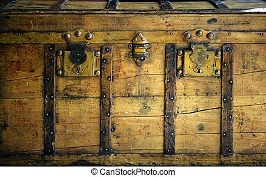 Old wooden chest, trunk in golden color and rusty