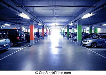 Backlit indoor car parking in blue cold light, shiny floor