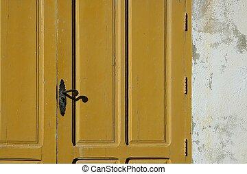 Aged wooden color door in mediterranean