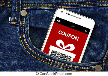 mobile phone with christmas coupon in pocket - mobile phone...