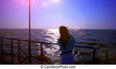 Carefree woman in sunset on the pier. vacation vitality...