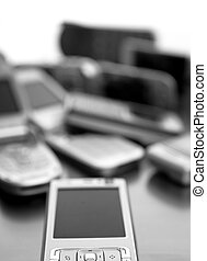 Assorted mixed mobile phones, old, new technology in cell...