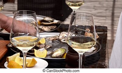 tasting oysters with some wine