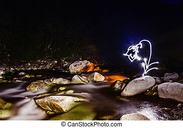 Light Painting - Beautiful light figures at the river in...