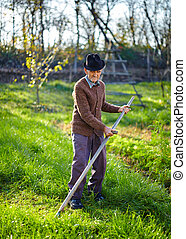 Old farmer with scythe