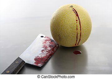 Bloody yellow melon killed by knife. Wound with blood...