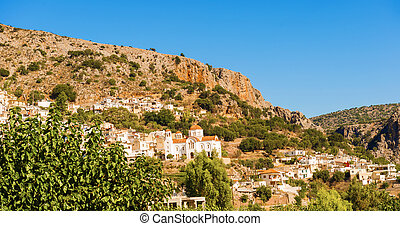 Town of Kritsa in Crete, Greece. - Panoramic view at town of...