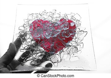 Hand holding a broken glass heart - Hand holding a plate of...